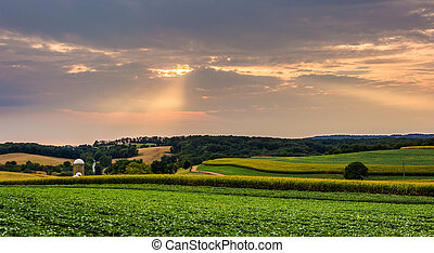 Sunset over farm fields and rolling hills in rural York County, Pennsylvania.