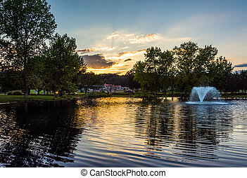 Sunset over fountain pond in Luray, Virginia
