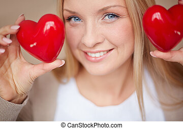 Girl with hearts - Image of smiling female with two red...