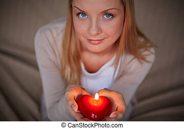 Woman with candle - Image of smiling female with burning...