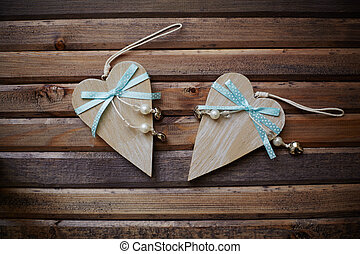 Wooden hearts - Image of wooden hearts with blue ribbons and...