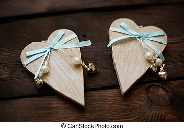 Decorative hearts - Image of wooden hearts with blue ribbons...