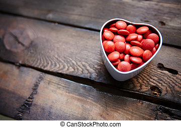 Gourmand love - Red small candies in heart shaped box...