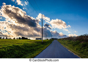 Sunset sky over a country road near Cross Roads, Pennsylvania.