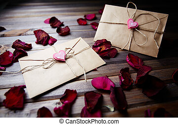 Love letters - Image of two letters of love with small pink...