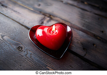 Fragrance of love - Image of red heart shaped candle burning...