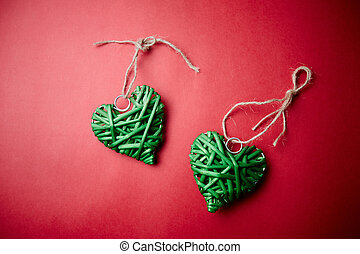 Green hearts - Image of decorative green hearts on red...