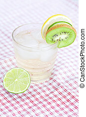 water with lemon and lime,kiwi in a glass with ice