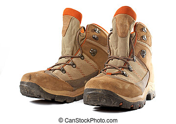Hiking boots - A pair of used hiking boots over a white...