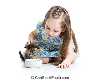 funny child feeding attractive kitten - funny child boy...