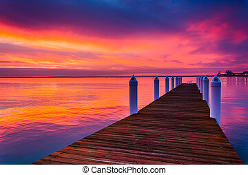 Pier and sunset over the Chesapeake Bay, seen from Kent Island, Maryland.