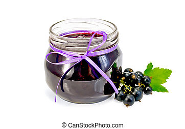 Jam of blackcurrant in a glass jar - Glass jar with black...