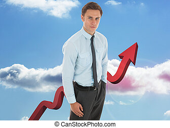 Composite image of serious businessman with hand in pocket -...