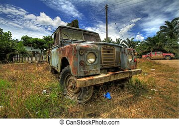 Old abandoned cars Stock Photo - Rusting vehicle found in...