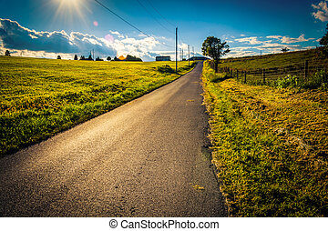 The sun setting over a country road near Cross Roads, Pennsylvania.