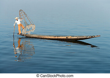 Traditional fishing by net in Burma - Traditional fisherman...