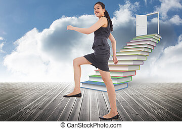 Composite image of businesswoman stepping up - Businesswoman...