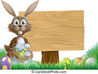 Rabbit and Easter sign - Easter bunny rabbit with a wooden...