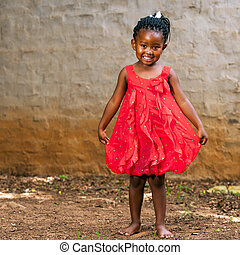 African girl showing red dress. - Full length portrait of...