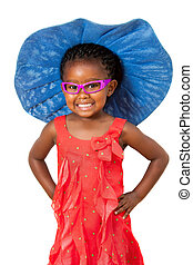 African girl with big blue hat. - Comical portrait of small...