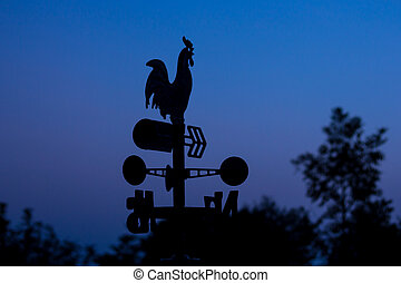Silhouette wheather vane at dawn
