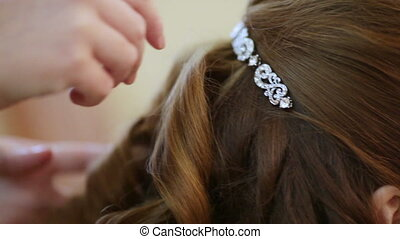Hairstyle - Hairdresser makes styling