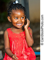 Happy african girl talking on smart phone. - Close up...