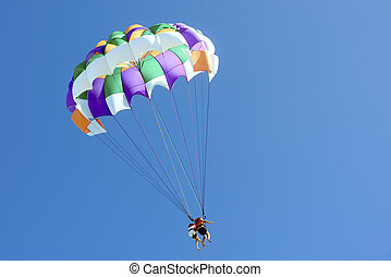 couple,parasailing in the clear sky