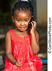 Sweet african girl on cell phone - Close up portrait of cute...