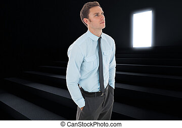 Composite image of serious businessman with hands in pockets...