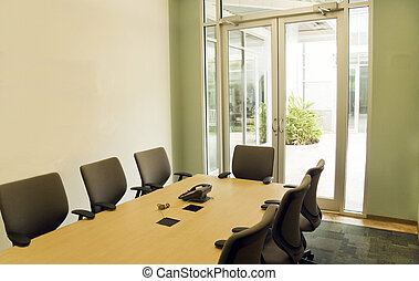 Conference Room - A small modern conference room for office...