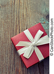 Red elegant gift box on a wooden background