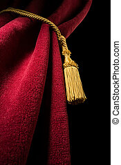 Red velvet curtain with tassel Close up black isolated...
