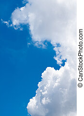 Rain clouds building up on a sunny day with blue sky...