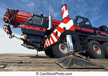 Mobile crane - A huge powerful mobile crane and its support...