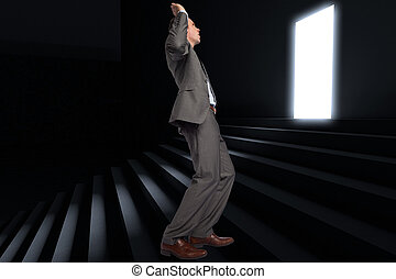 Composite image of businessman posing with hands up -...