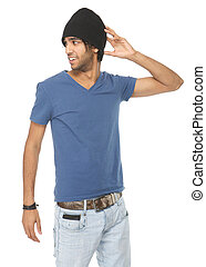 Young male fashion model in jeans and black hat