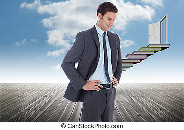 Composite image of smiling businessman with hands on hips -...