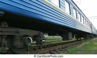 Blue passenger train in movement.