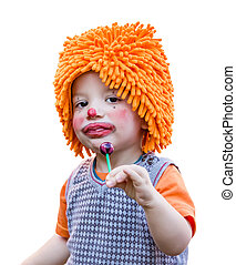 Clown child eating a lollipop on white background - Portrait...