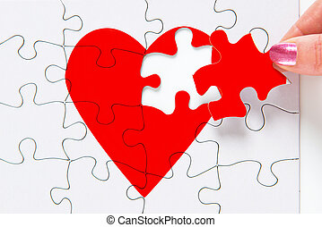 Mending a broken heart - A woman putting the missing piece...