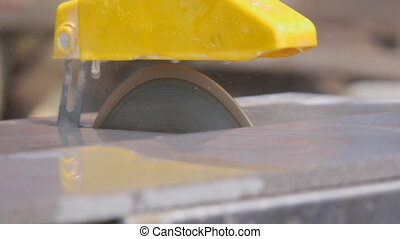 Circular saw in operation - Circular saw is spinning at high...