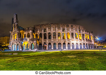 Colosseum at night in Rome, Italy - The Iconic, the...