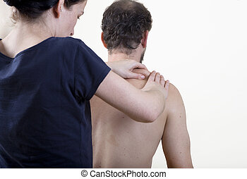 physiotherapist knead - a physiotherapist treats a patient....