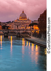 Vatican and river Tiber in Rome - Italy at night .