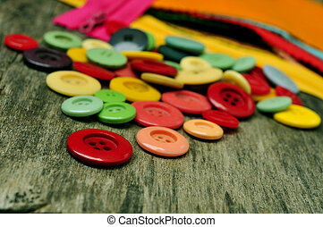buttons, fabric and zippers - a pile of buttons, fabric and...
