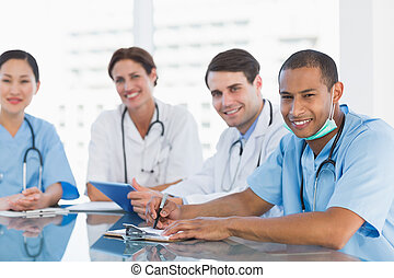 Young doctors in a meeting at hospital - Portrait of a group...