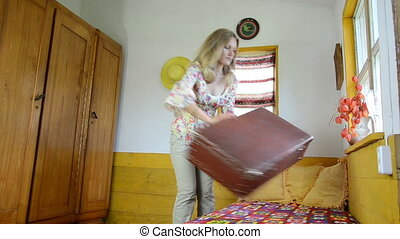 clothes suitcase - girl takes a big suitcase from the closet...