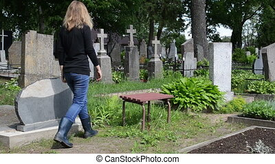 woman depressed cemetery - Depressed woman mourn near...