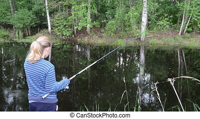 girl pulls rod - girl in cool summer day standing at the...